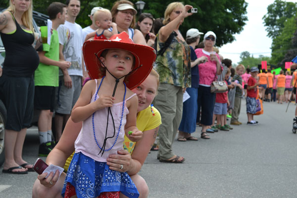 Sarah Doane, dressed in patriotic colors, watches Farmington's Fourth of July parade.