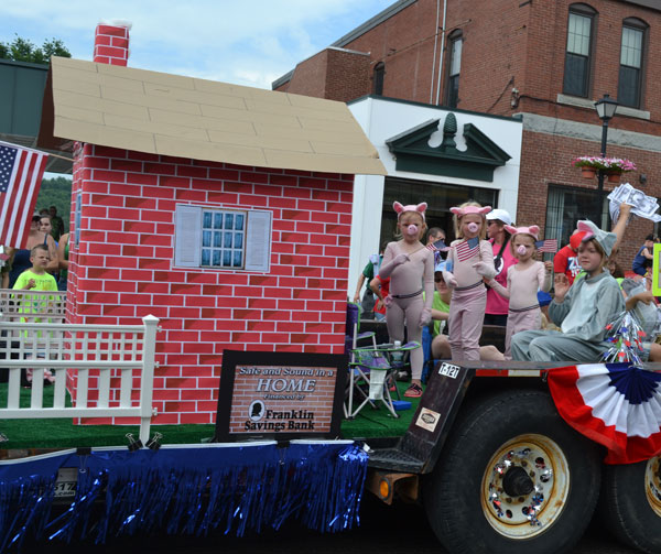 Franklin Savings Bank's parade entry with the my favorite book theme of  The Three Little Pigs.